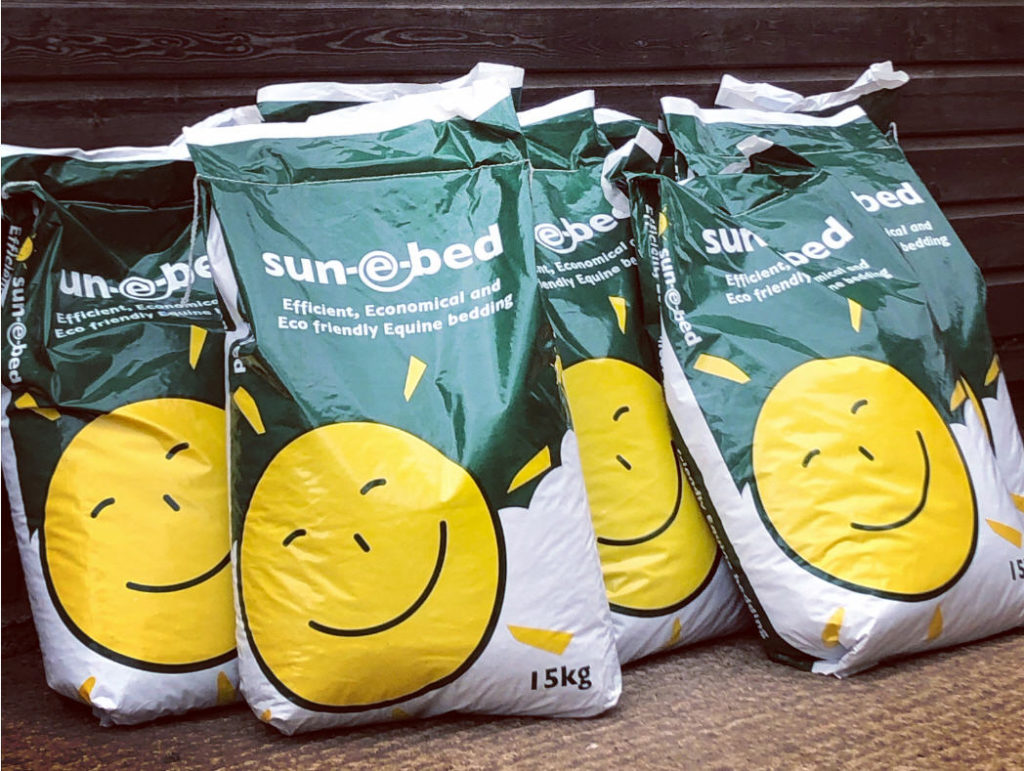sun e bed bags in front of stable